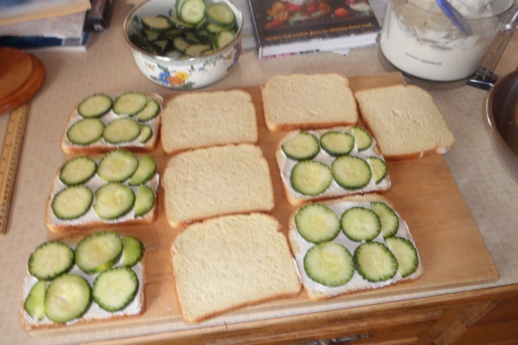 Each large sandwich takes five cucumber slices. Close then take off the edges.