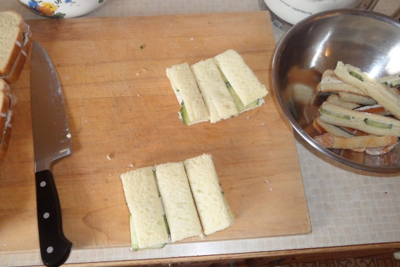 Crusts off, cut in thirds.  Yum.